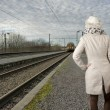 Back view of woman wating for her train — Stock Photo