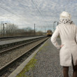 Back view of woman wating for her train — Stock Photo #19126049