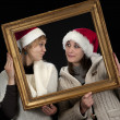Two young women in a frame, — Stock Photo
