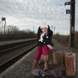 Bored young woman waiting for her train — Stock Photo