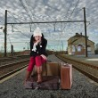 Young woman waiting for her train — Stock Photo
