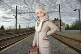Woman wating for her train — Stock Photo