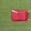 Top view of wheelbarrow on grass field — Stock Photo