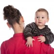 Baby looking over his mother's shoulder — Stock Photo