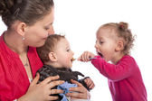 Little girl feeding her baby brother — Stock Photo