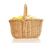 Basket with easter eggs, isolated on white — Stock Photo
