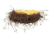 Nest made of yellow feathers with Easter eggs — Stock Photo