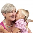 Little girl with grandmother on white — Stock Photo