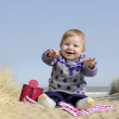 Little baby playing on the beach — Stock Photo #24082787