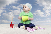 Baby playing in sand — Stock Photo
