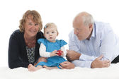 Grandparents with granddaughter, isolated on white — Stock Photo