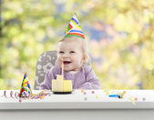 Baby having her first birthday, blurred background — Stock Photo
