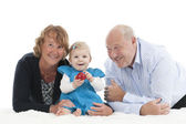 Grandparents with granddaughter, isolated on white — Photo