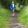 Summer holidays, girl running in the woods — Stock Photo