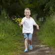 Mother's day : little boy with flowers , outdoors — Stock Photo