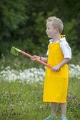 Gardening, cute little boy with rake, outdoors — Stockfoto