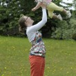 Mother throwing her baby in the air,outdoors — Stock Photo