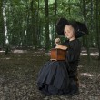 Halloween witch outdoors in the woods — Stock Photo