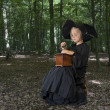 Halloween witch outdoors in the woods — Stock Photo #30800087