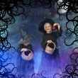 Stock Photo: Two little halloween witches at night, with stars and moon