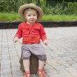 Stock Photo: Little toddler with straw summer hat, outdoors