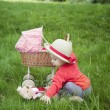 Little toddler playing with a pram outdoors — Stock Photo #31484309