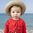 Little toddler with summer straw hat — Stock Photo