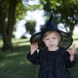 Little halloween witch outdoors — Stock Photo