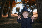 Little halloween witch outdoors — Stockfoto