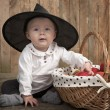 Halloween baby with basket of apples — Stock Photo
