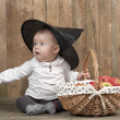 Halloween baby with basket of apples — Stock Photo #32582113