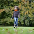 Girl running in the park — Stock Photo