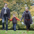 Family walking in  apark — Stock Photo