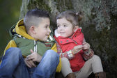 Brother and sister talking to each other outdoors — Stock Photo
