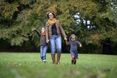 Mother and children walking in the park — Foto de Stock