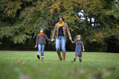 Mother and daughters walking a the park — Stock Photo