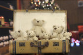 Lots of teddy bears in an old vintage suitcase — Stock Photo