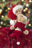 Little santa baby with christmas hat — Stock Photo