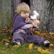 Little toddler in an autumn park — Stock Photo #35733697