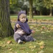 Little toddler in an autumn park — Stock Photo #35733775