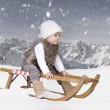 Little toddler outdoors in snow in alps — Stock Photo #36668535
