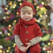 Little toddler in front of a christmas tree — Stock Photo