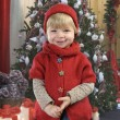 Little toddlerin front of a christmas tree — Stockfoto