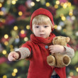 Little toddler in front of a christmas tree — Stockfoto