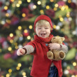 Little toddler in front of a christmas tree — Foto Stock
