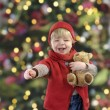 Little toddler in front of a christmas tree — Φωτογραφία Αρχείου