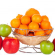 Bucket of red and green apples and oranges on white — Stock Photo