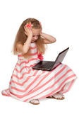 Adorable little girl stressed by laptop isolated on white backgr — Stock Photo