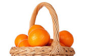 Basket of fresh oranges, mandarines or tangerines isolated on wh — Stock Photo