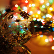 Colorful silhouette of christmas ball on new year's bokeh backgr — Stock Photo #36596433